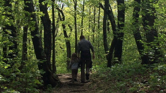 mom and child walking in woods We Are Wildness